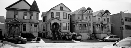 A row of old Victorian homes on Oak St in Oakland.